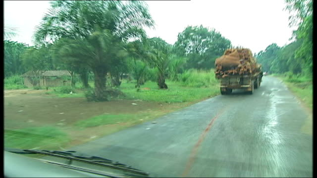 aka pygmy tribe under threat by deforestation central sequence point of view shots through windscreen of car driving up remote road through forest... - overtaking stock videos and b-roll footage