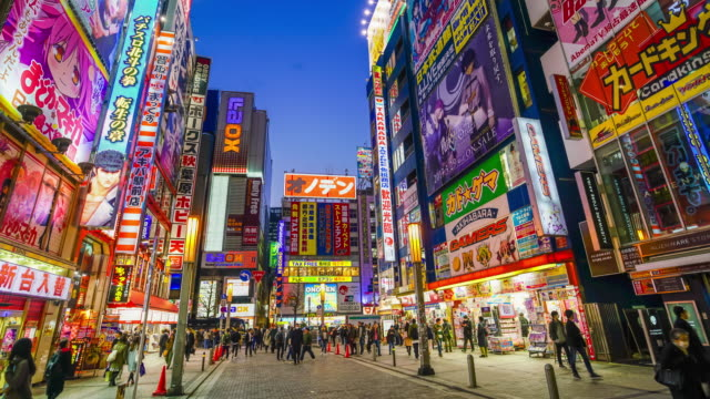 akihabara electronics hub at twilight - giappone video stock e b–roll