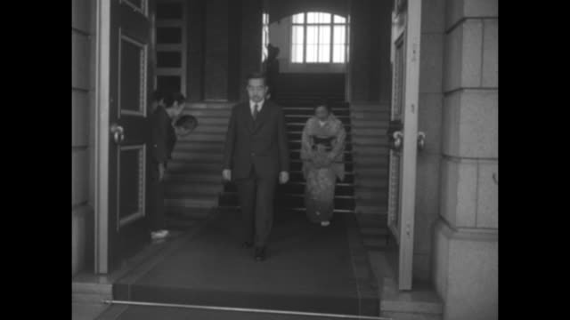 akihito standing for photo opportunity between his father emperor hirohito on his right and his wife princess michiko on his left / closer view of... - coronation stock videos and b-roll footage