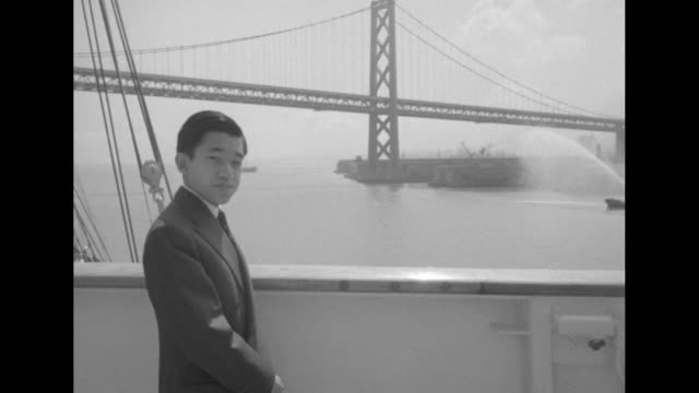 vs akihito stands on deck of ss president wilson looks out toward fireboat and golden gate bridge / vs cu akihito japanese men and ship rigging in... - japanese royalty stock videos and b-roll footage