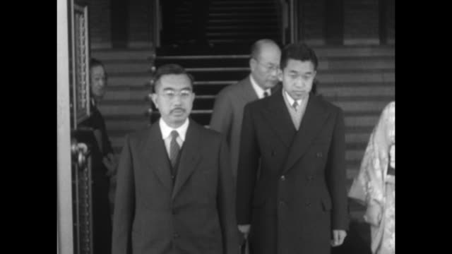 akihito walking down stairs with his father emperor hirohito to his right and his wife princess michiko to his left all three stop at bottom of... - japanese royalty stock videos and b-roll footage