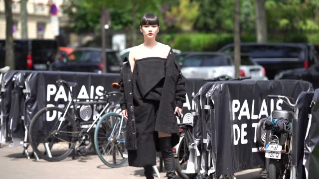 akimoto kozue wears a black coat, a black dress, black boots, outside rick owens, during paris fashion week - menswear spring-summer 2019, on june... - black dress stock videos & royalty-free footage