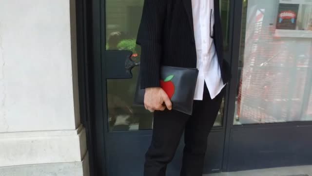 Akira Ono wearing a Caruso jacket Barry pants Jim Western shoes Pelle Morbida bag during Milan Men's Fashion Week SS17 on June 19 2016 in Milan Italy