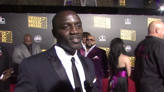 akon on what he's wearing what he's looking forward to on music on his ipod that might surprise people and on what he's working on at the 2008... - mp3 player stock videos & royalty-free footage