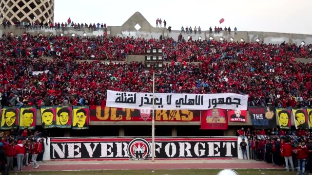 al ahly football team fans commemorate the port said stadium riot victims, at mokhtar altitch stadium in cairo, egypt on february 01, 2016. 72 people... - port said stock videos & royalty-free footage