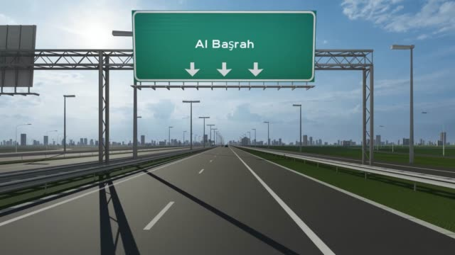 al basrah city signboard on the highway conceptual stock video indicating the entrance to city - basra stock videos & royalty-free footage