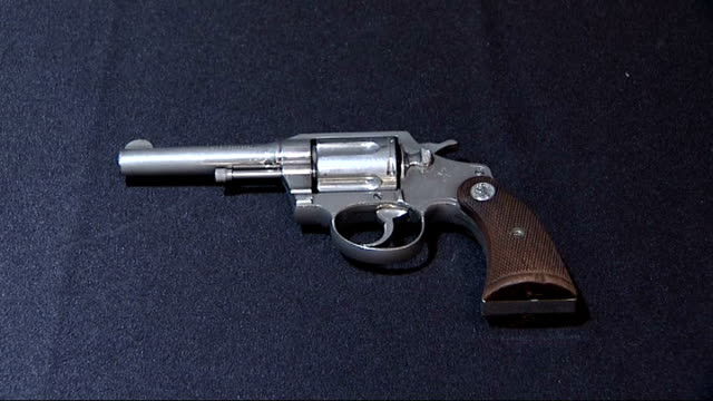 al capone's gun sells for 67000 pounds at auction england int close shot of revolver once owned by gangster al capone being handled by auctioneer... - handgun stock videos & royalty-free footage