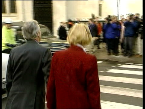 neil hamilton in witness box; england: london: high court: ext neil hamilton and wife christine hamilton towards along street for libel case against... - spokesman stock videos & royalty-free footage