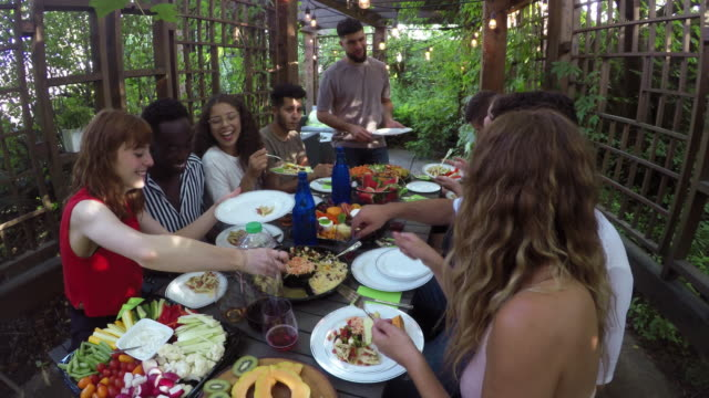 al fresco outdoor meal summer young adults multi ethnic group - gardening equipment stock videos & royalty-free footage