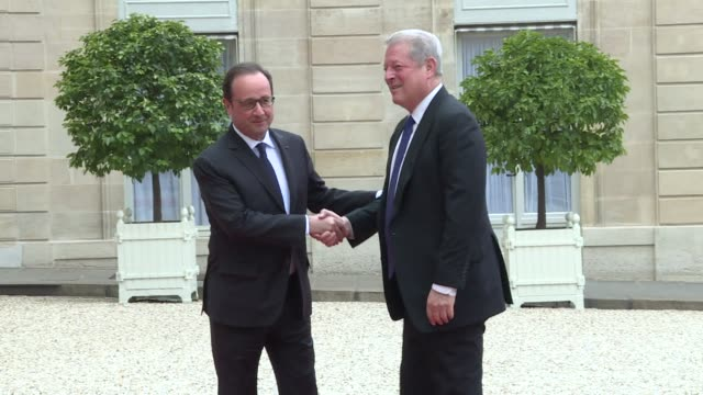 vídeos de stock, filmes e b-roll de al gore meets french president francois hollande who will be hosting a major un climate conference in paris in december - a. gore