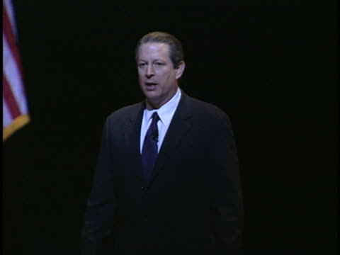 stockvideo's en b-roll-footage met al gore speaking to an audience about global warming criticizes the bush administration on foreign policy and the invasion of iraq - united states and (politics or government)