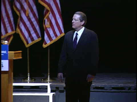 al gore speaks to an audience about global warming, indicating two different futures. - environment or natural disaster or climate change or earthquake or hurricane or extreme weather or oil spill or volcano or tornado or flooding stock videos & royalty-free footage