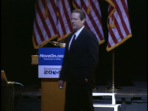 al gore speaks to an audience about global warming, relating a personal story about unchallenged assumptions. - environment or natural disaster or climate change or earthquake or hurricane or extreme weather or oil spill or volcano or tornado or flooding stock videos & royalty-free footage