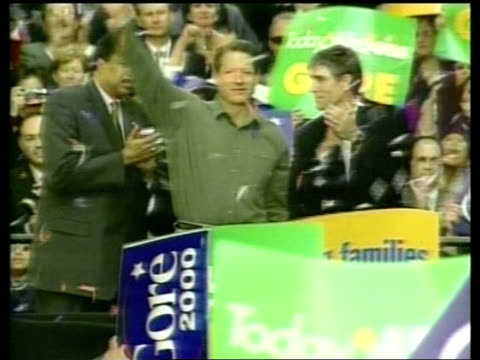 ms al gore waving at podium during campaign rally as confetti falls around him pull out to show people waving banners - al gore stock videos and b-roll footage
