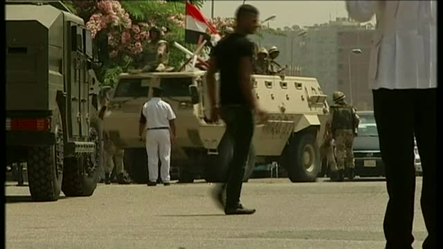 al jazeera journalists mohamed fahmy and baher mohamed sent back to prison after a re-trial; t04071303 / tx 4.7.2013 armoured vehicle or tank with... - crime or recreational drug or prison or legal trial stock-videos und b-roll-filmmaterial