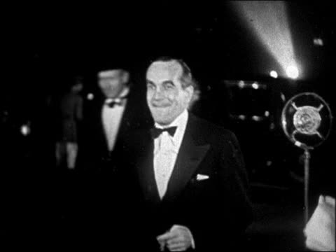 al jolson in tuxedo posing for photos at interference premiere / newsreel - 1928 stock-videos und b-roll-filmmaterial