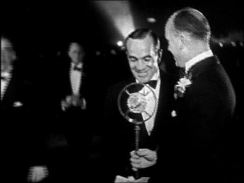 al jolson in tuxedo talking into microphone at interference premiere / newsreel - 1928 stock-videos und b-roll-filmmaterial