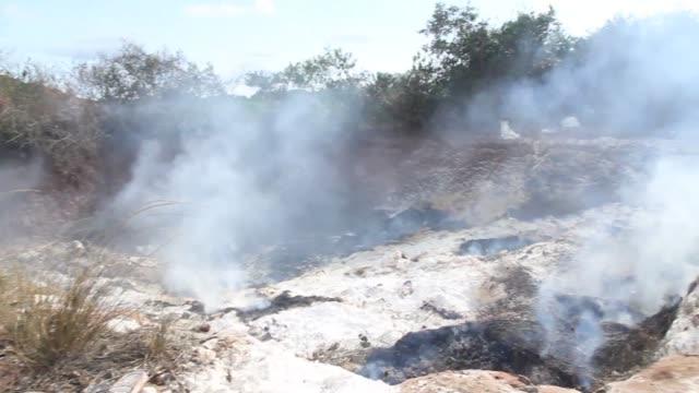 al menos dos policias murieron y 61 personas sufrieron quemaduras graves tras una explosion en un deposito de basura en cotonou en benin - benin stock videos and b-roll footage