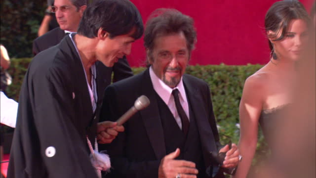 PAN Al Pacino speaking with reporter as he walks down the red carpet with Lucila Sola