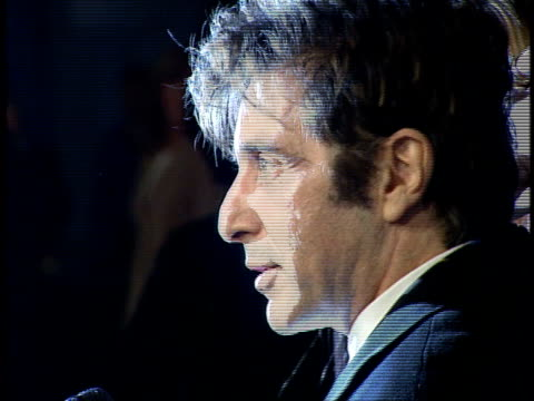 Al Pacino speaks to a reporter on the red carpet