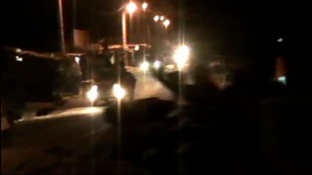 Al Qaeda militants seize vast area of northern Mali Timbuktu Pickup trucks along street DAY Various of trucks carrying militants along Abdulhamid...