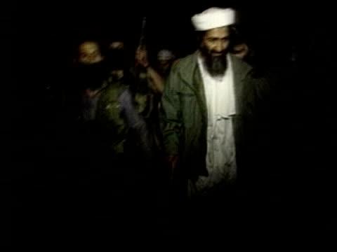 sir john stevens comments aptn = no osama bin laden picture on screen - al qaida stock videos & royalty-free footage