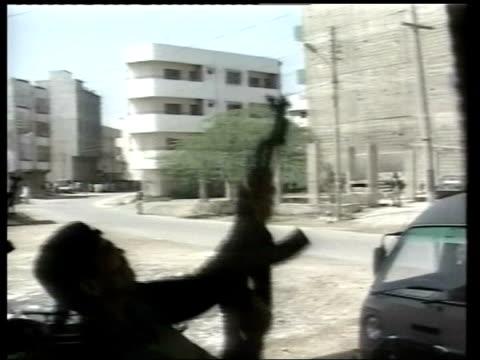 al qaida suspect khalid sheikh mohammed arrested lib no resale karachi ms police officer firing gun in air during police shoot out with terrorist... - al qaida stock videos & royalty-free footage