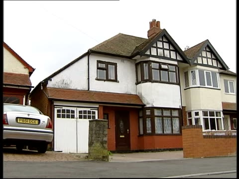 al qaida terror suspects to face military tribunal; itn england: birmingham: gv moazzam begg's home - moazzam begg stock videos & royalty-free footage