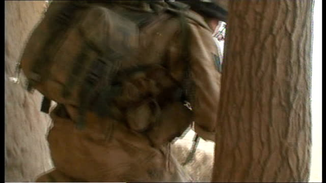 al qaida terrorists switch focus from iraq tx ext british soldier behind tree as fires gun at militant fighters sot - al qaida stock videos & royalty-free footage