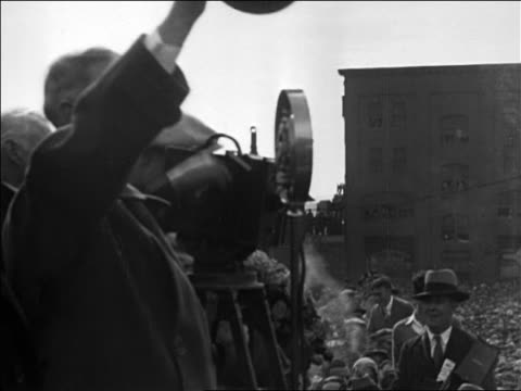 Al Smith standing by cameraman waving to crowd at rally / Chicago / documentary