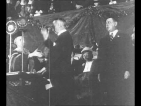 vídeos de stock e filmes b-roll de al smith takes the oath of office during his fourth inauguration as ny governor in 1927 / smith in the governor's office during his previous term;... - instrumento de escrita