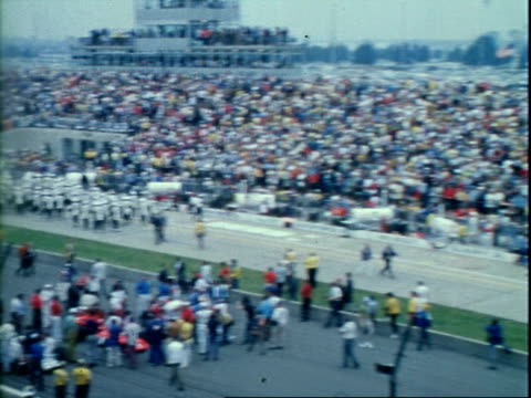 al unser sr driving colt ford roger mccluskey racing scorpion ford at indianapolis motor speedway / race car driver lloyd ruby wearing racing... - start flag stock videos & royalty-free footage