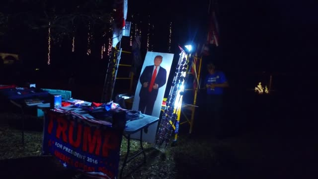 Alabama election DATE Image of then Presidential candidate Donald Trump and campaign table as lights switched on