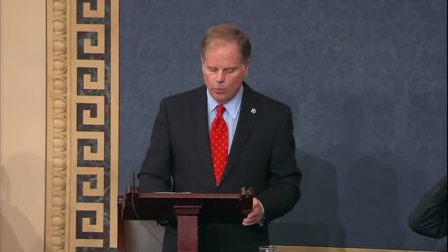 alabama senator doug jones concludes his maiden speech to the senate in hopes that in walking through the double doors to the senate floor the senate... - double chance stock videos & royalty-free footage