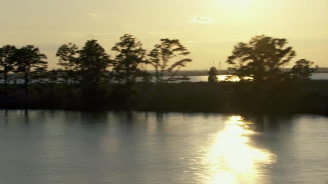 alabama wetlands at sunset. - alabama video stock e b–roll