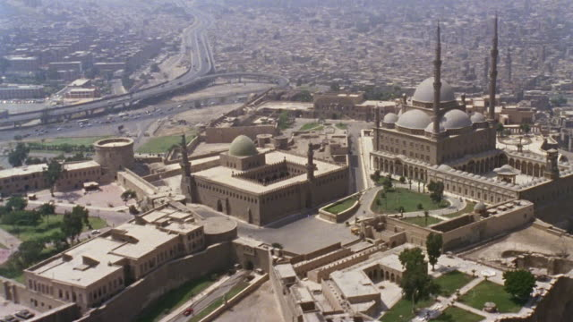 aerial ws alabaster mosque and fortress in cityscape / cairo, egypt - fortress stock videos & royalty-free footage