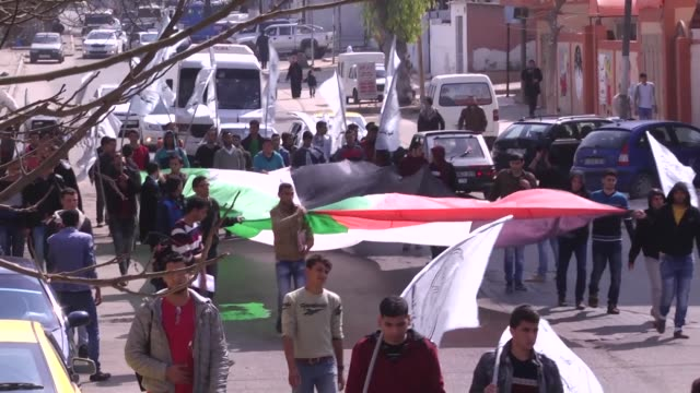 alahrar movement organised a student march in solidarity with the palestinian detainee mohammed alqeeq who is on hunger strike in the israeli prisons... - detainee stock videos and b-roll footage