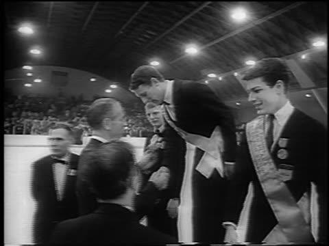 vídeos y material grabado en eventos de stock de alain calmat being crowned winner at world figure skating championships / newsreel - sólo hombres jóvenes