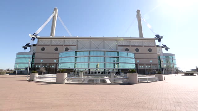 alamodome w/ city buildings reflecting in glass empty plaza white hot sun in clear blue sky - empty glass stock videos and b-roll footage