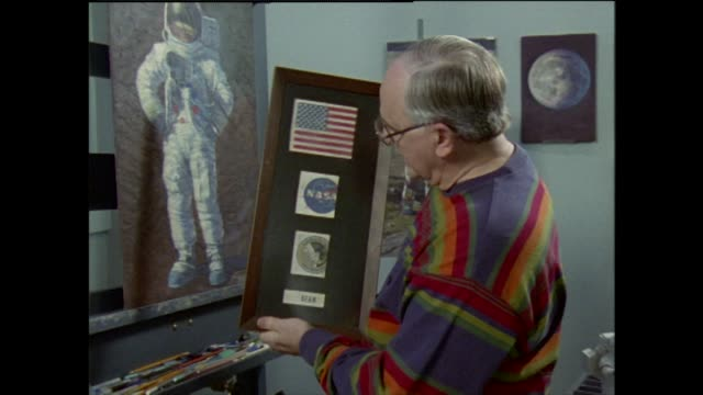 alan bean nasa astronaut explains how he uses moon dust from his spacesuit in his paintings and the meaning that has - textured effect stock videos & royalty-free footage