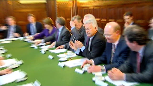 alan duncan sitting, with others, at conservative shadow cabinet meeting zoom in as he eats a biscuit - alan duncan stock videos & royalty-free footage