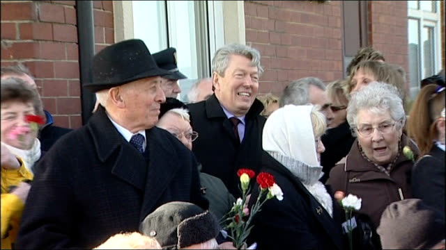 alan johnson possible donations irregularities location unknown ext alan johnson mp amongst crowd of people some carrying red and white carnations - alan johnson stock videos & royalty-free footage