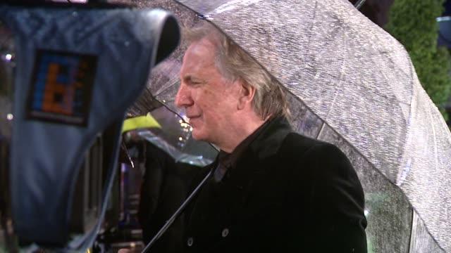 alan rickman at the alice in wonderland royal world premiere at london england. - アラン・リックマン点の映像素材/bロール