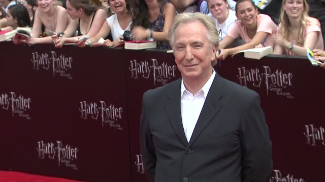 alan rickman at the 'harry potter and the deathly hallows: part 2' new york premiere - arrivals at new york ny. - アラン・リックマン点の映像素材/bロール