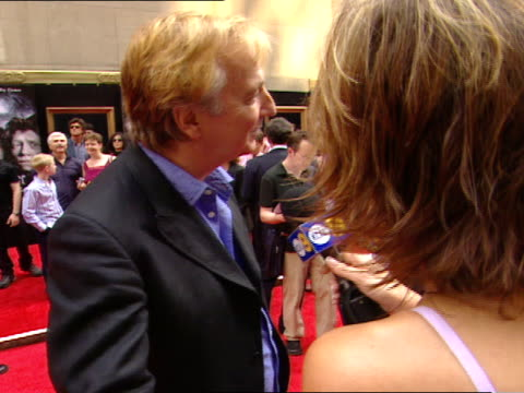 day alan rickman standing on red carpet near radio city music hall talking to press female reporter - radio city music hall stock videos and b-roll footage