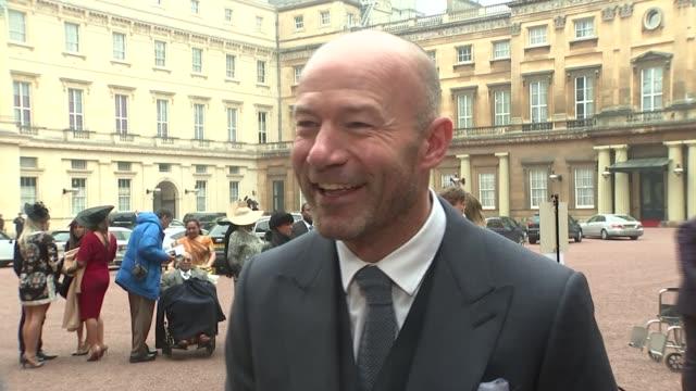 Alan Shearer interview and photocall ENGLAND London Buckingham Palace EXT Alan Shearer along and interview SOT Alan Shearer photocall with CBE medal...