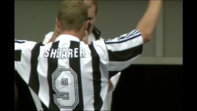 Alan Shearer signs for Newcaste United Announcer on platform whipping up the crowd / Alan Shearer onto platform wearing Newcastle United shirt Alan...