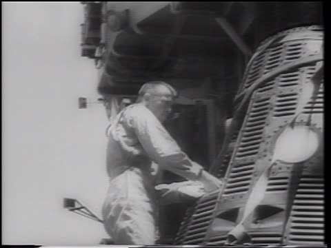alan shepard looking in doorway of mercury 3 space capsule after flight - 30代の男性だけ点の映像素材/bロール