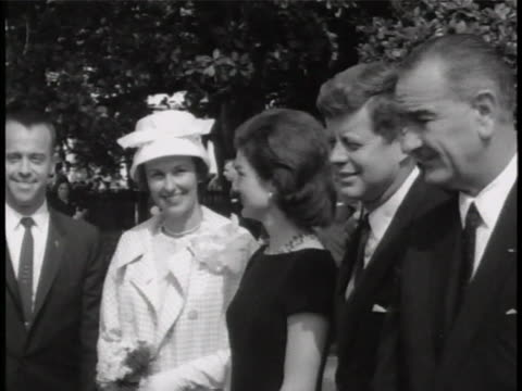 alan shepard shakes president john f. kennedy's hand and exchange a few words. also in the shot, is alan shepard's wife louise and the vice president... - alan b. shepard jr stock videos & royalty-free footage