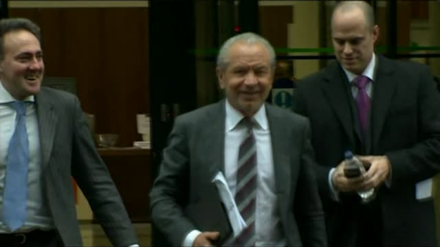 alan sugar forced to apologize following racist tweet london photography*** alan sugar along from building with legal team - alan sugar stock videos and b-roll footage